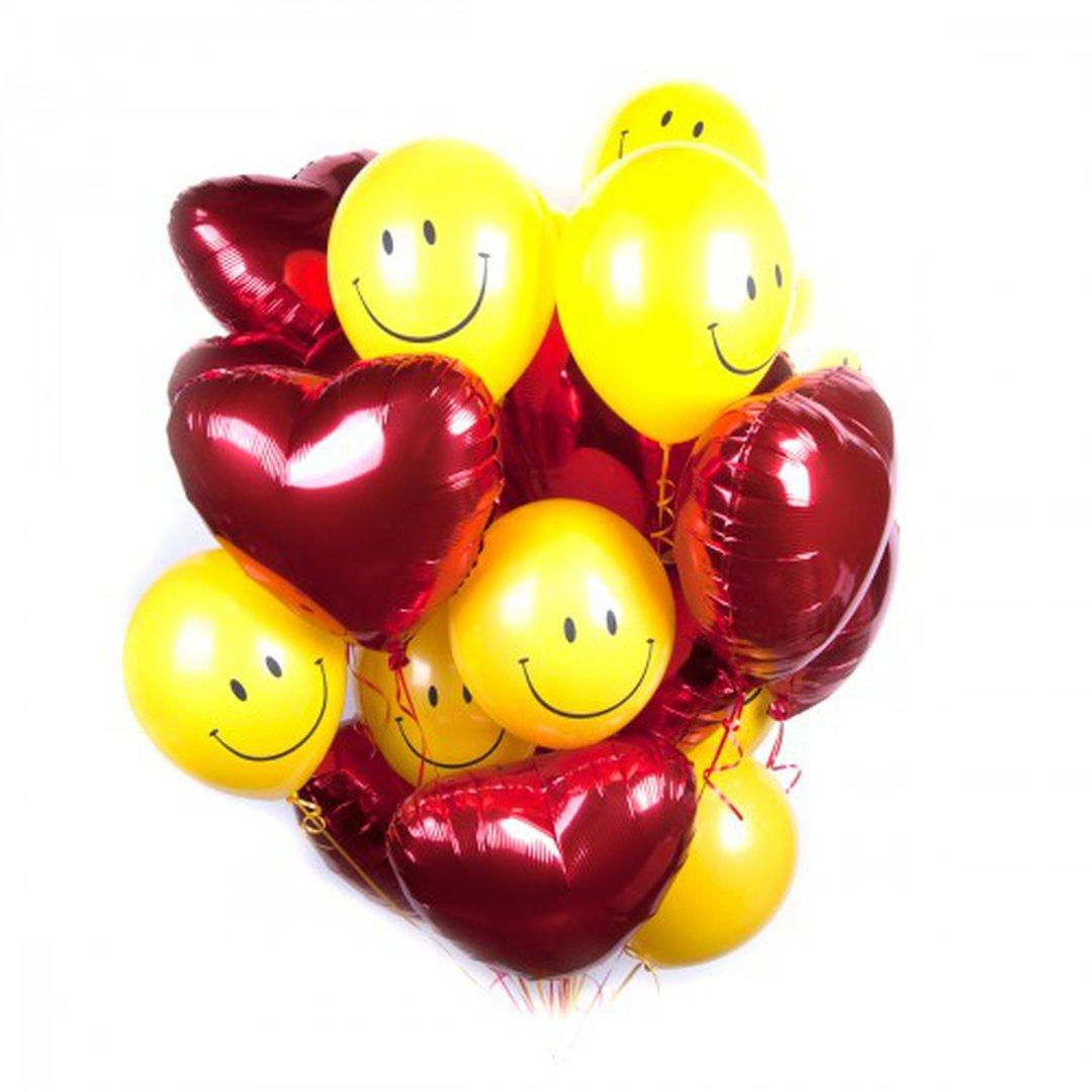 Фольгированный шарик смайл с сердечками.